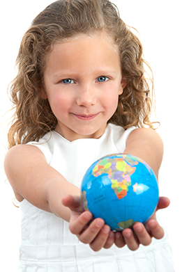A smiling girl holding a globe