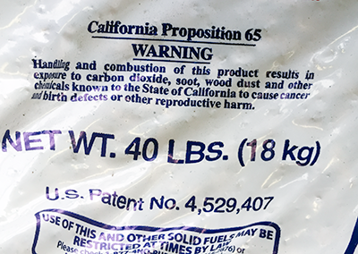 Photo of bag of pellets displaying a California Prop 65 toxicity warning.