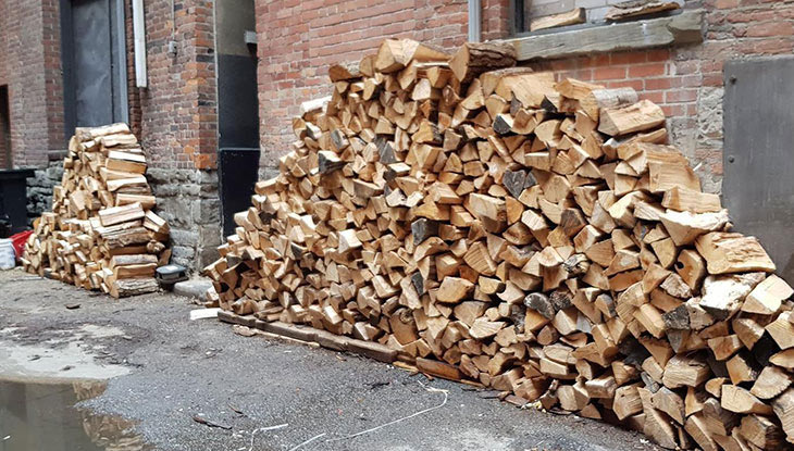 A woodpile in the alley behind the restaurant.